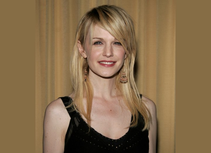 Kathryn Morris wearing hair extensions and pieces for a personable look
