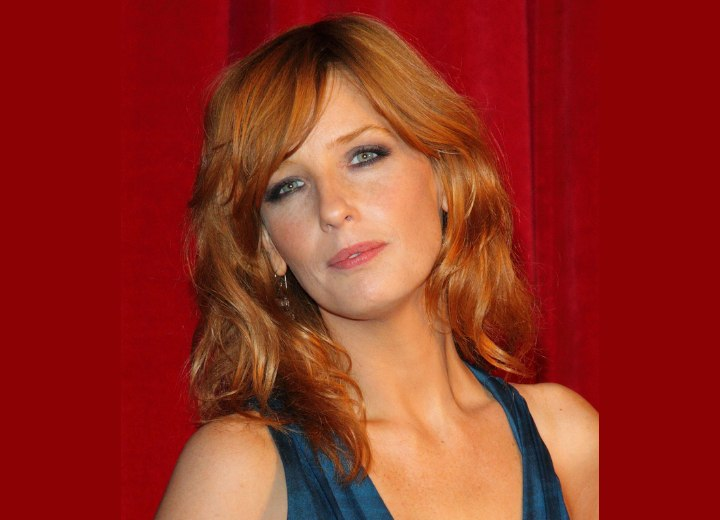 Kelly Reilly - Long hairstyle with a fringe that sweeps across the forehead
