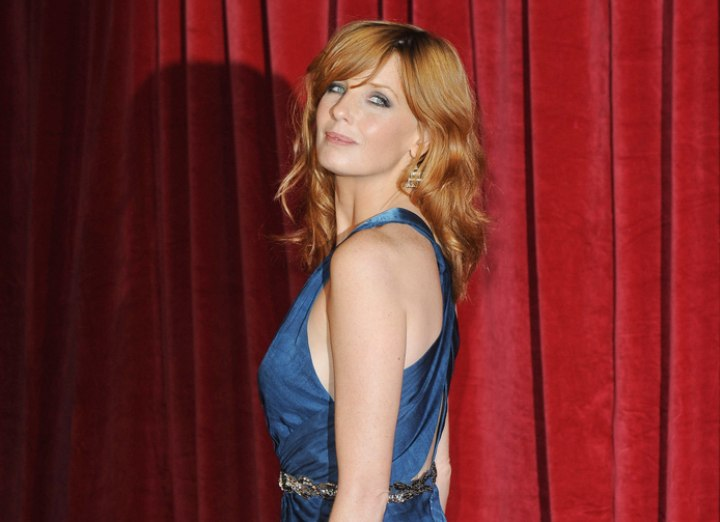 Kelly Reilly wearing a gown that makes her hair shine