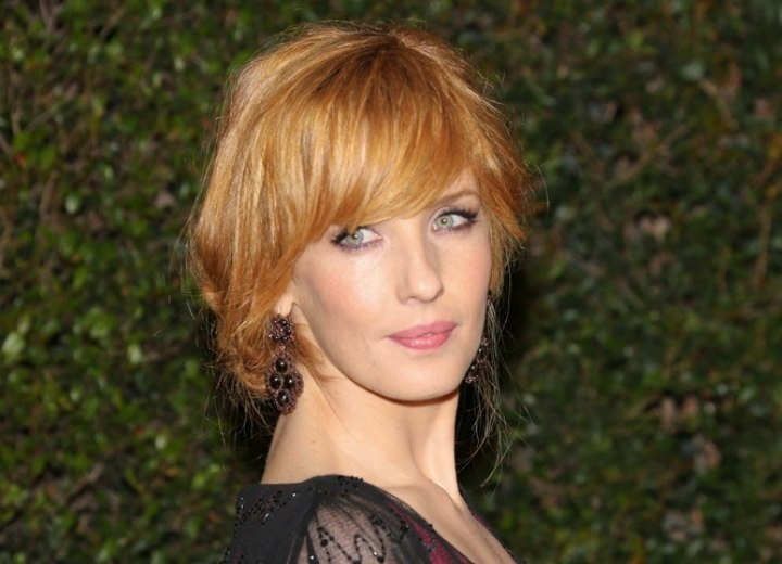 Kelly Reilly wearing her hair in a loose up-style