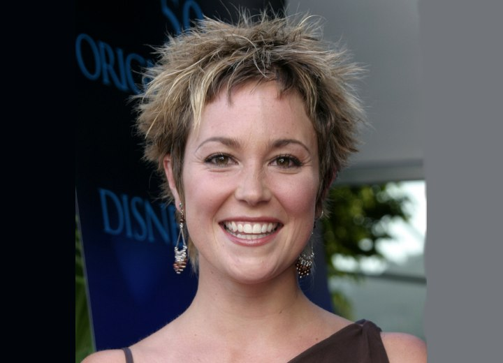 Kim Rhodes with short chopped hair