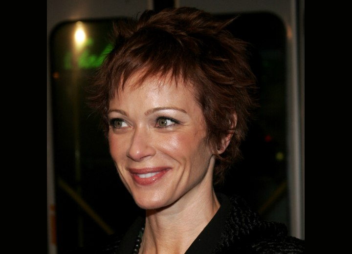 Lauren Holly sporting a short pixie haircut