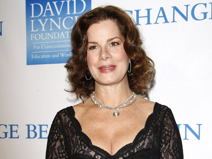 Marcia Gay Harden - Medium length curly hairstyle