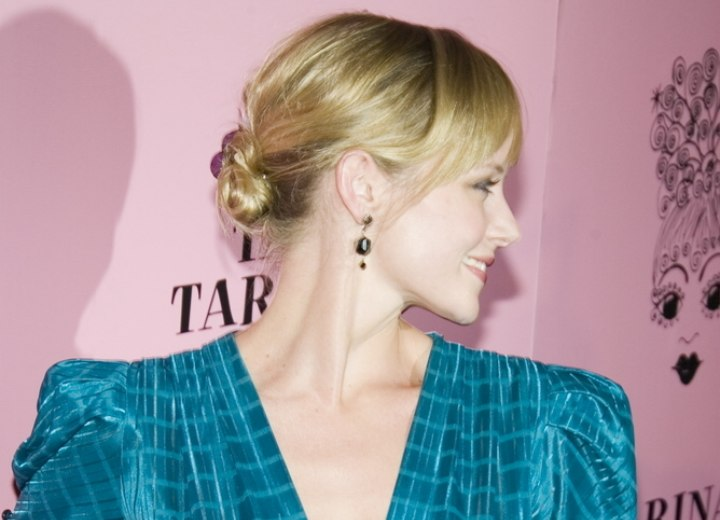 Marley Shelton - Side view of her hair styled up in a knot