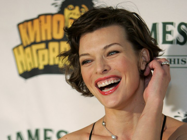 Milla Jovovich with short hair and exposed ear lobes