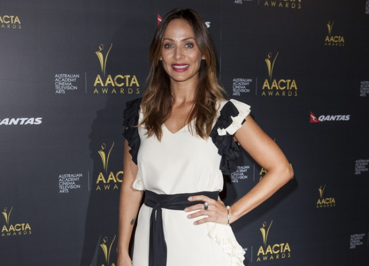 Natalie Imbruglia's youthful look with long hair and a dress
