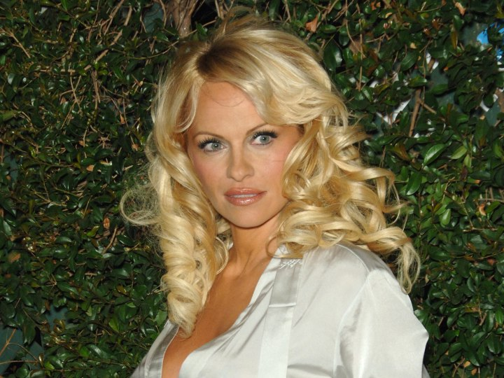 Pamela Anderson with glossy blonde hair