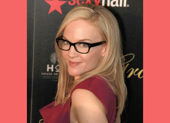 Rachael Harris wearing her black framed glasses