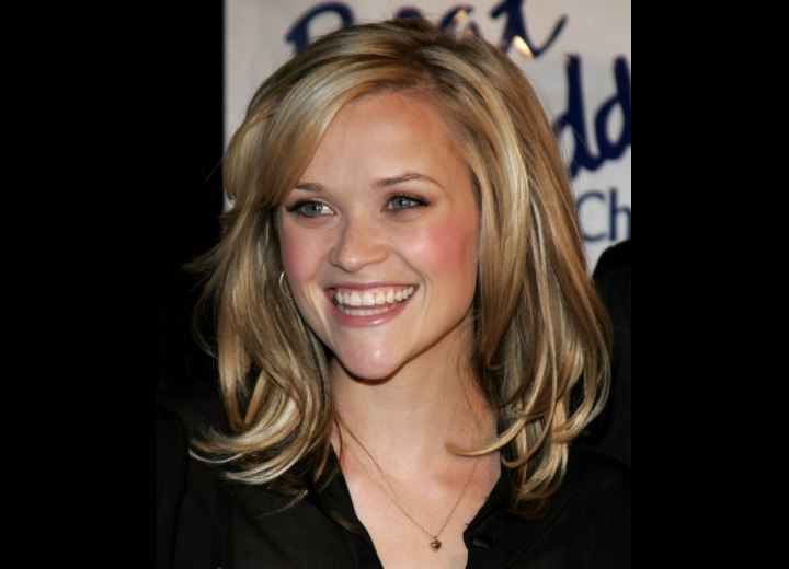 Reese Witherspoon with her hair cut in long layers