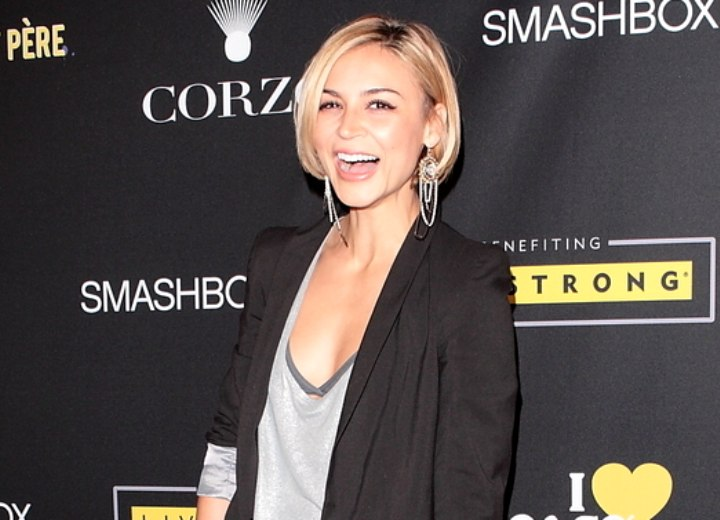 Samaire Armstrong wearing long leather boots