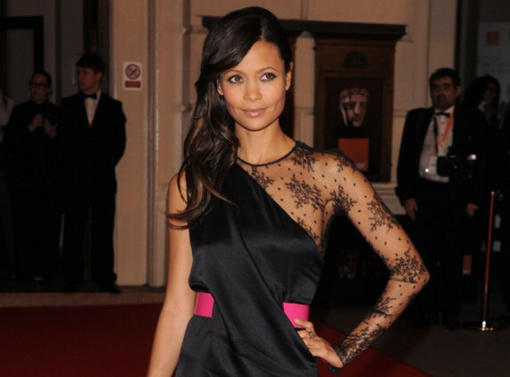Thandie Newton wearing a silk dress with a sheer sleeve