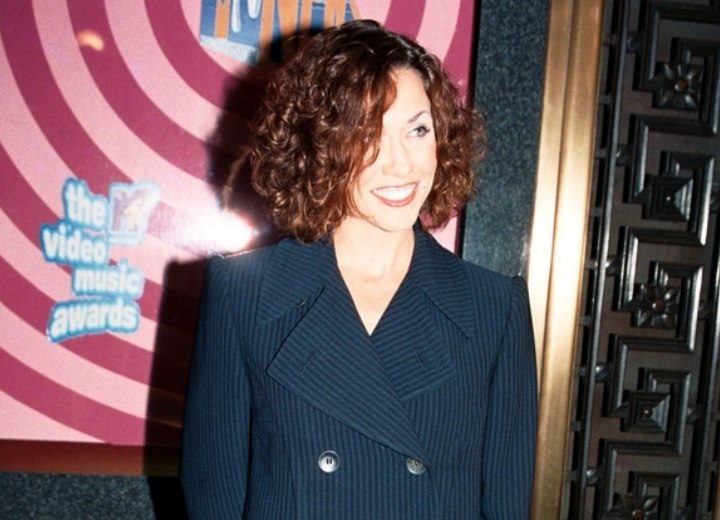 Sheryl Crow with short curly hair