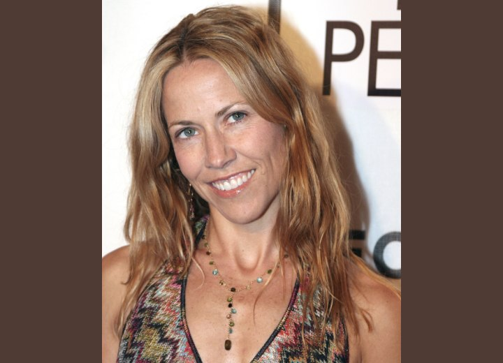 Sheryl Crow with long hair