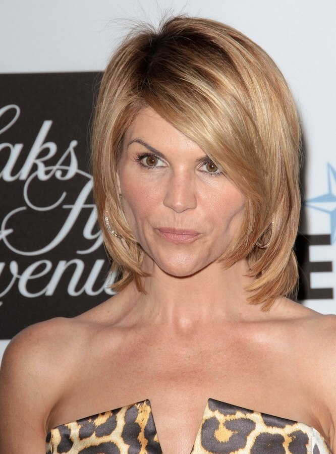 Lori Loughlin sporting a medium long swing haircut