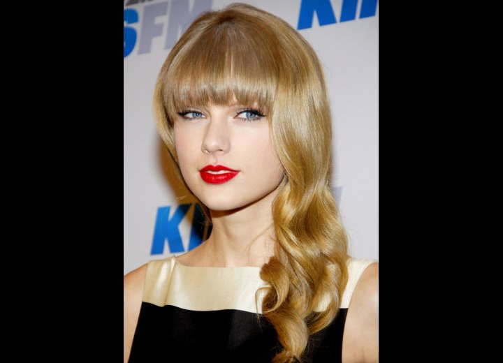 Taylor Swift wearing her hair long with full bangs