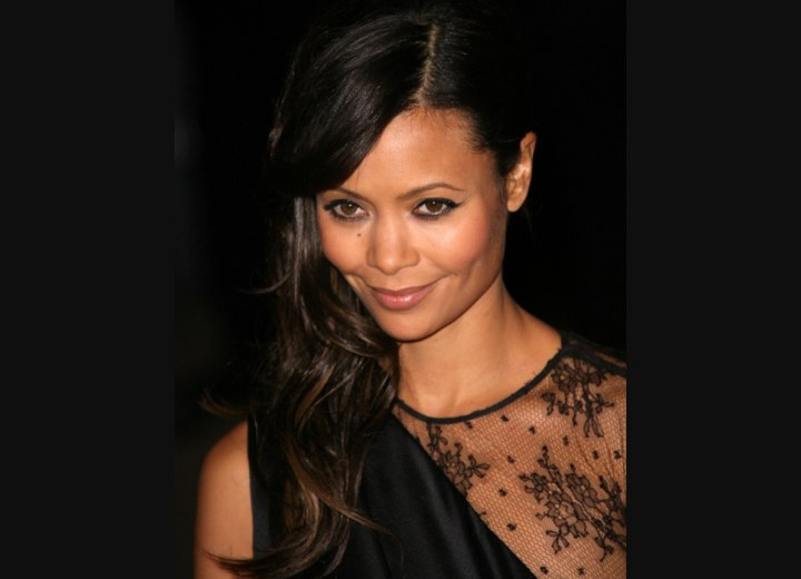 Thandie Newton wearing her hair styled in front of one shoulder