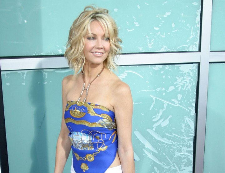 Heather Locklear wearing a wrap around top