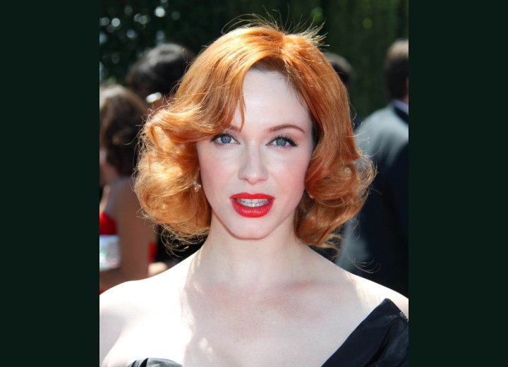 1950s hairstyle for red hair with waves - Christina Hendricks