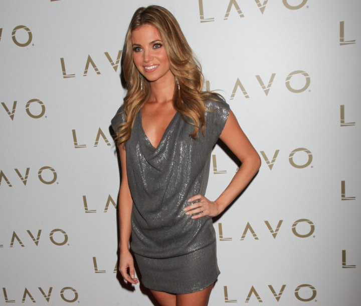 Amber Lancaster wearing a shimmery dress with a scooped neckline