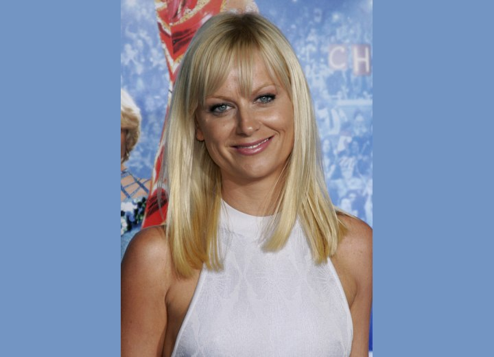 Amy Poehler - Long straight hairstyle for a more mature look