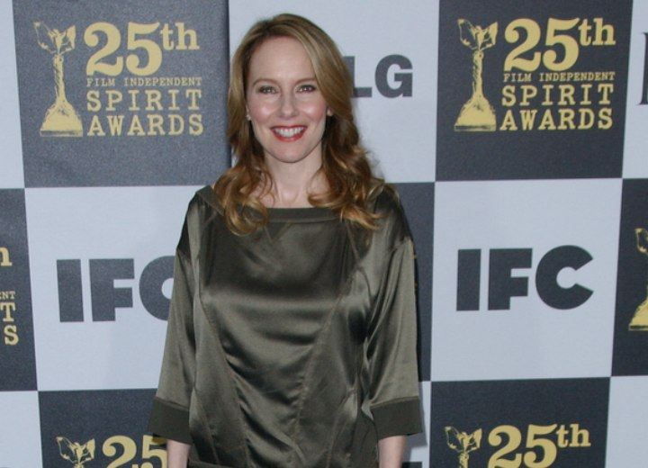 Amy Ryan wearing a shimmery green above the knees dress
