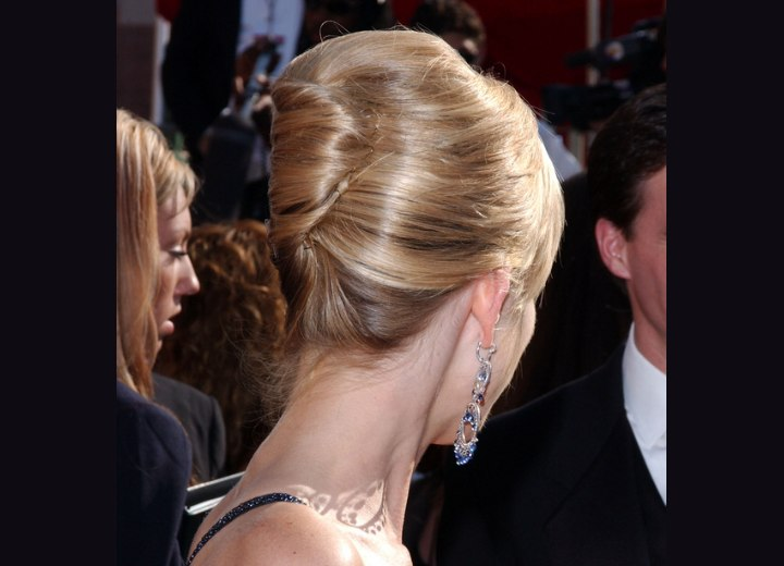 Back view of an updo with a banana roll - Courtney Thorne-Smith