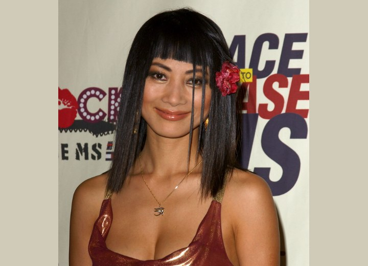Bai Ling wearing a flower in her straight black hair