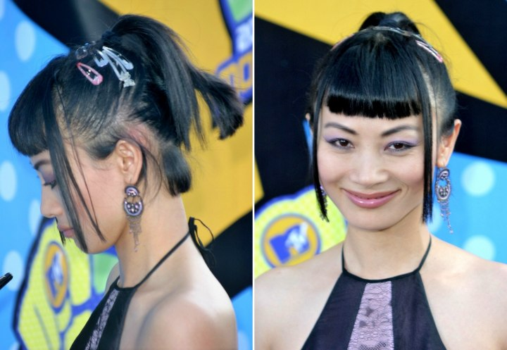 Bai Ling wearing her black hair in a high ponytail