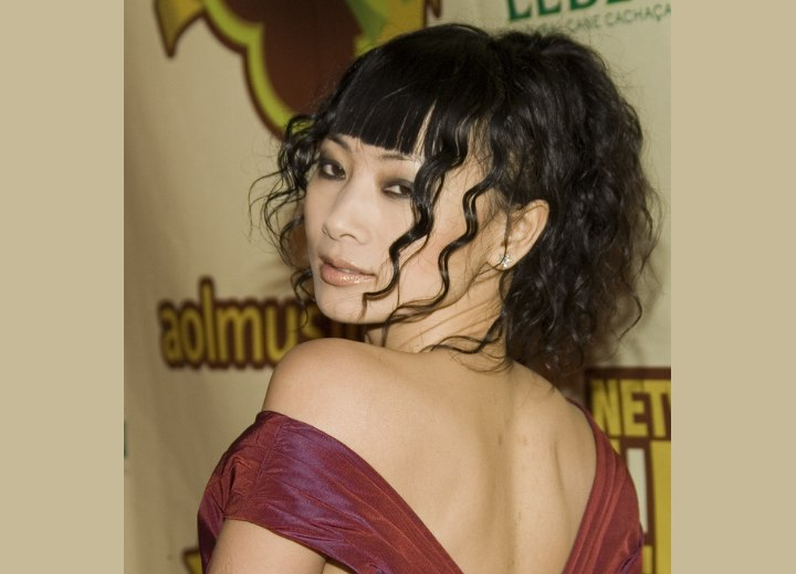 Side view of Bai Ling's updo with curls