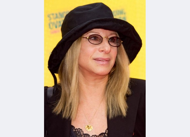 Barbara Streisand with long hair and wearing a hat