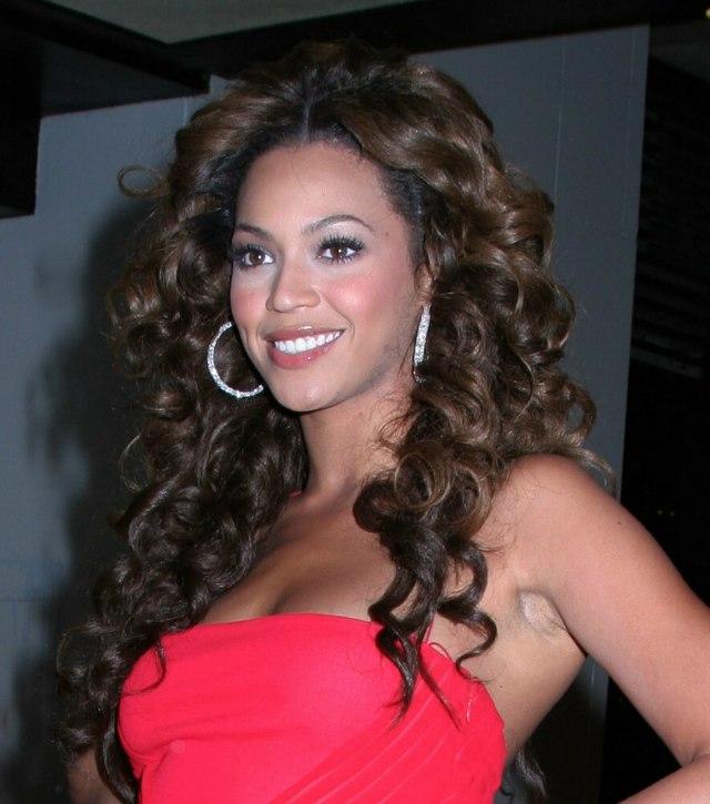 Beyonce wearing her hair flowing in deep brown curls past her shoulders