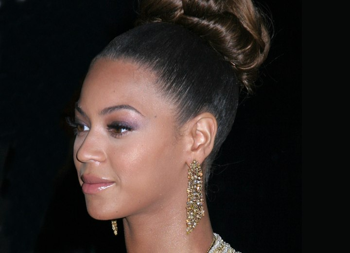 Beyonce's up-style with a cluster of curls