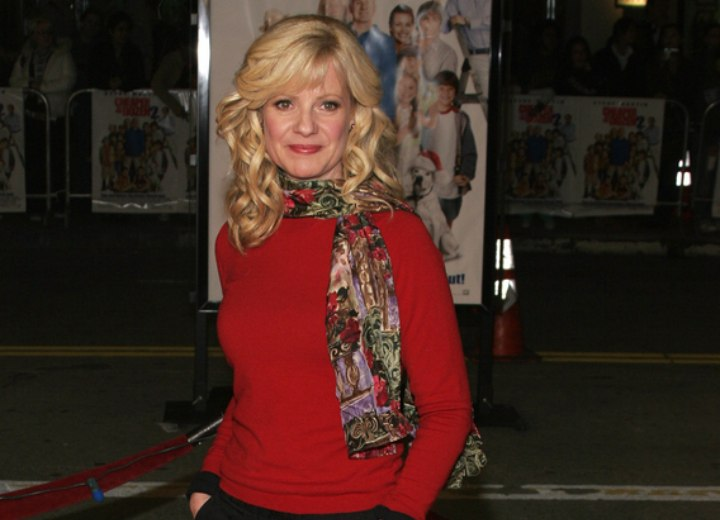 Bonnie Hunt wearing a red sweater and a colorful scarf