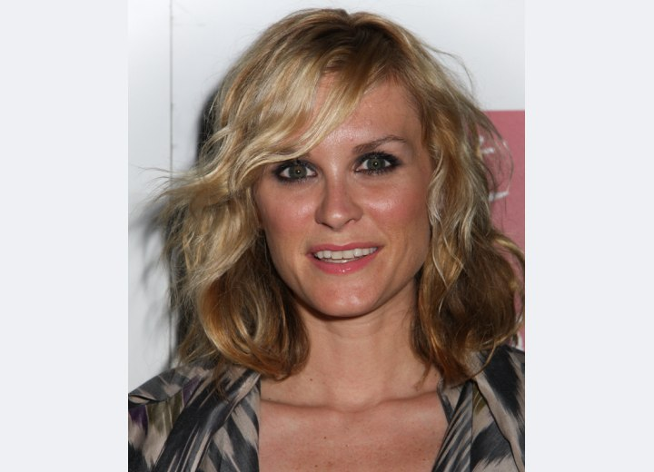 Bonnie Somerville with hair that touches the shoulders