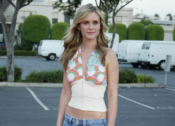 Bonnie Somerville wearing jeans and a backless summer top