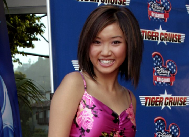 Brenda Song wearing a purple flower print dress
