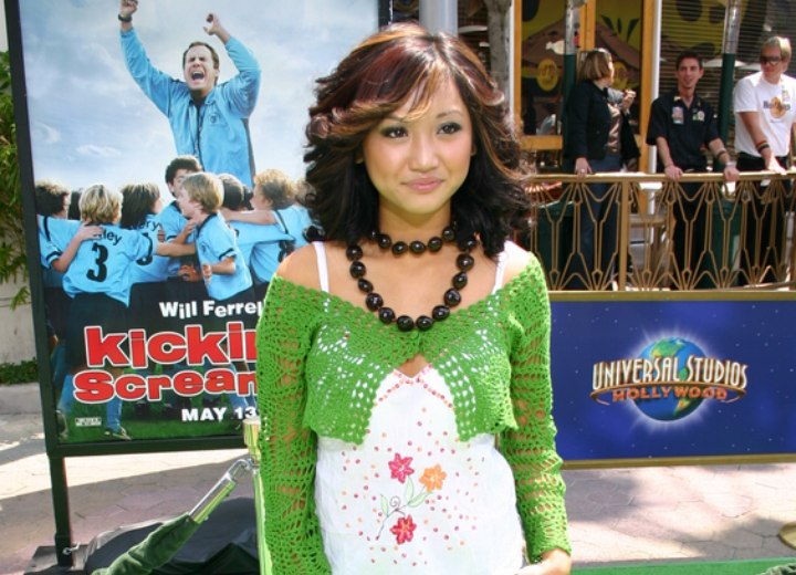 Brenda Song wearing a green top