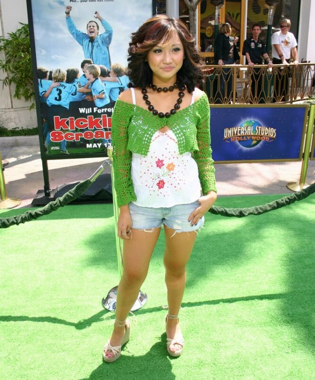 Brenda Song Wearing Her Hair Curled To Feather Back Away