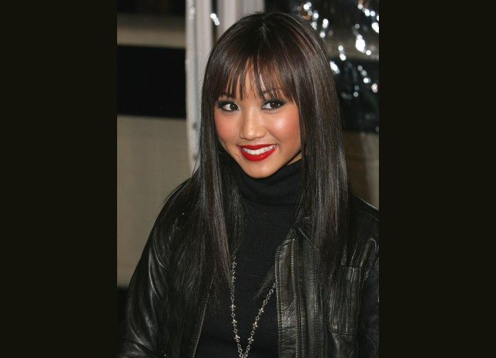 Brenda Song wearing her hair sleek and long