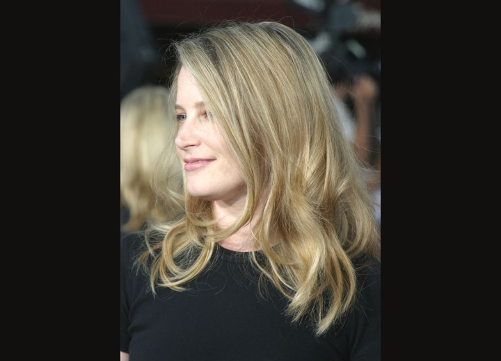 Side view of Bridget Fonda's long hairstyle