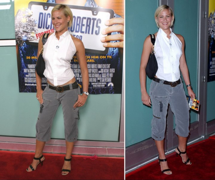 Brittany Daniel wearing a white halter blouse