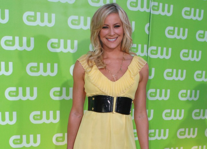 Brittany Daniel wearing a short yellow dress