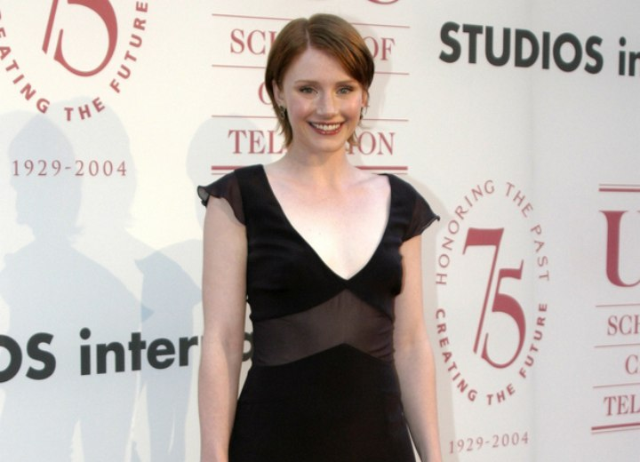 Bryce Dallas Howard with short hair and wearing a dress