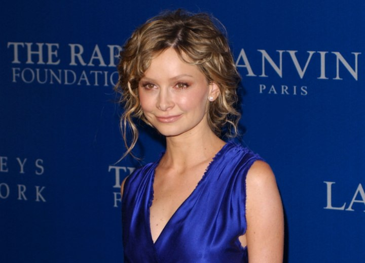 Calista Flockhart wearing her curly hair up with volume