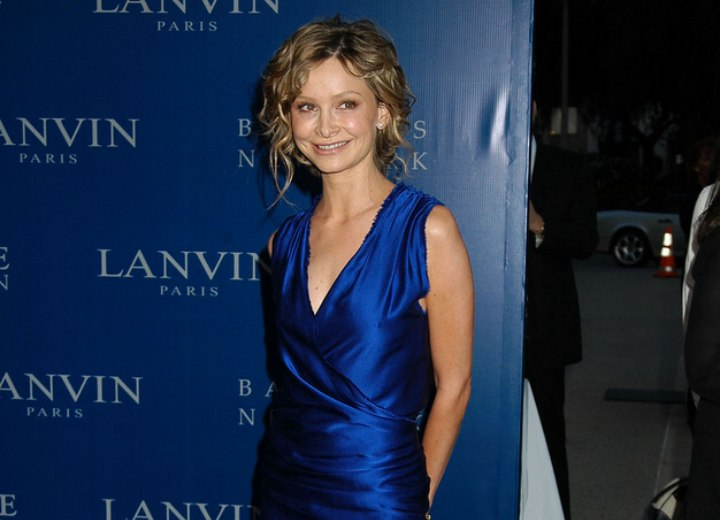 Calista Flockhart wearing a blue silk dress