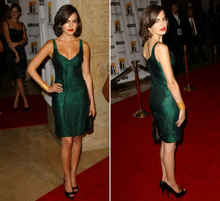 Camilla Belle wearing a green brocade dress