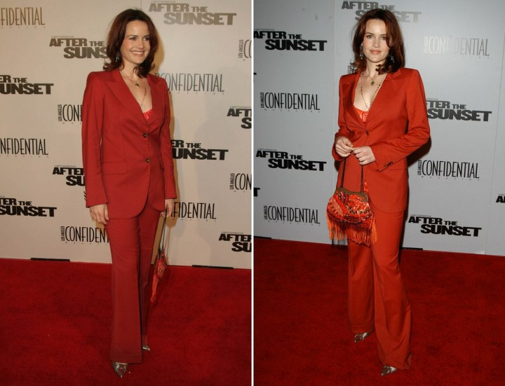 Carla Gugino wearing a red business suit