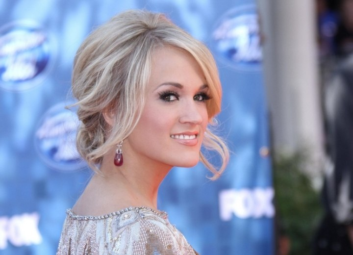 Side view of Carrie Underwood's loose up-style