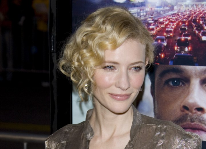 Cate Blanchett's hair styled up with curls along the side of her face