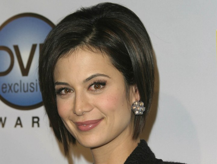 Catherine Bell wearing her hair in a bob with lift at the scalp